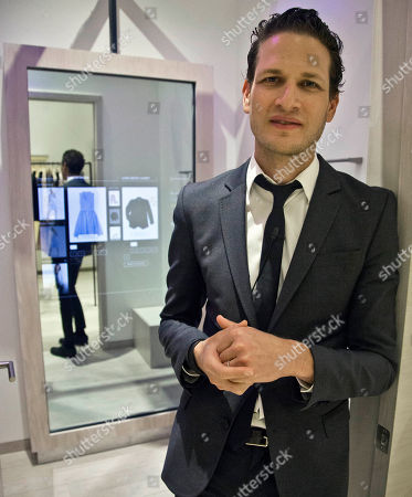 Uri Minkoff Uri Minkoff, the company CEO and brother of designer Rebecca Minkoff, poses outside a fitting room equipped with eBay's touch screen fitting room technology, at Rebecca Minkoff in New York. The interactive technology provides a virtual assistant inside fitting rooms for shoppers, displaying their selections and a catalog to modify choices and accessorize