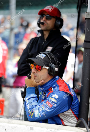 Tony Kanaan, Dario Franchitti Tony Kanaan, of Brazil, bottom, and former Indianapolis 500 champion Dario Franchitti, of Scotland, watch from behind the pit wall during practice for the Indianapolis 500 auto race at Indianapolis Motor Speedway in Indianapolis