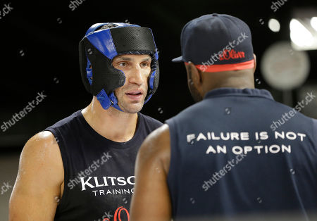 Wladimir Klitschko, Johnathon Banks Heavyweight World Champion boxer Wladimir Klitschko, talks to head trainer Johnathon Banks, right, as he spars during a media workout at the Lucky Street Gym, in Hollywood, Fla. Klitschko will defend his WBA and IBF heavyweight titles against Bryant Jennings on April 25 at Madison Square Garden