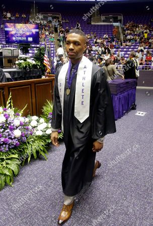 Damian Lillard Portland Trail Blazers point guard walks on to the floor of the Dee Events Center during Weber State's commencement exercises, in Ogden, Utah. Lillard graduated with a degree in professional sales from the College of Applied Science & Technology