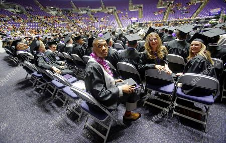 Damian Lillard Portland Trail Blazers point guard Damian Lillard, center, looks on during commencement exercises at Weber State, in Ogden, Utah. Lillard graduated with a degree in professional sales from the College of Applied Science & Technology