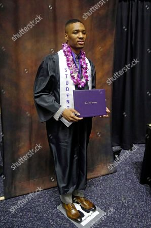 Damian Lillard Portland Trail Blazers point guard Damian Lillard poses for a photograph during commencement exercises at Weber State, in Ogden, Utah. Lillard graduated with a degree in professional sales from the College of Applied Science & Technology