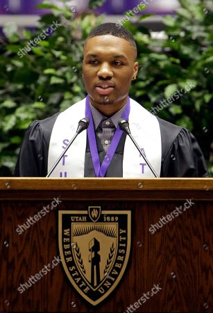 Portland Trail Blazers point guard Damian Lillard speaks during Weber State;s commencement exercises, in Ogden, Utah. Lillard graduated with a degree in professional sales from the College of Applied Science & Technology