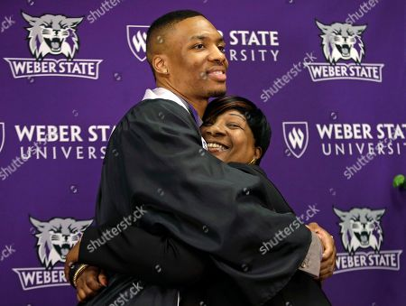 Damian Lillard, Gina Johnson Portland Trail Blazers point guard Damian Lillard hugs his mother Gina Johnson at a news conference at the commencement exercises at Weber State, in Ogden, Utah. Lillard graduated with a degree in professional sales from the College of Applied Science & Technology