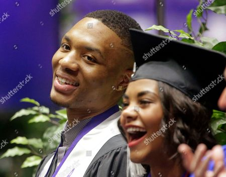 Damian Lillard Portland Trail Blazers point guard Damian Lillard and Shaquille Heath smile before speaking at the commencement exercises at Weber State, in Ogden, Utah. Lillard graduated with a degree in professional sales from the College of Applied Science & Technology