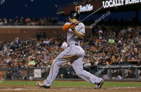 Giancarlo Stanton Miami Marlins' Giancarlo Stanton hits a sacrifice fly to score Dan Haren during the fifth inning of a baseball game against the San Francisco Giants in San Francisco