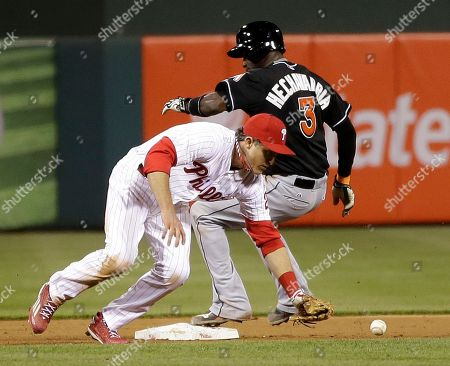 Chase Utley, Adeiny Hechavarria Philadelphia Phillies second baseman Chase Utley, left, commits a fielding error on a hit by Miami Marlins' Jeff Baker as Adeiny Hechavarria, right, reaches second during the eighth inning of a baseball game, in Philadelphia. Baker was safe at first on the error. Miami won 6-1