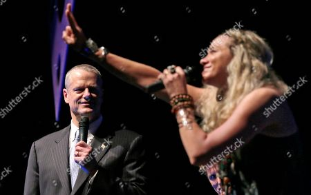 """Charlie Baker, Sally Taylor Mass. Gov. Charlie Baker, left, performs with singer Sally Taylor during the annual """"Banned in Boston"""" show in Boston, . Baker is moonlighting as a comedian and performer to help raise money for an anti-violence group the works with local teens. Sally Taylor is the daughter of James Taylor and Carly Simon"""