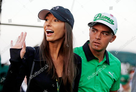 Rickie Fowler stands next to his friend Alexis Randock during the honorary tee off the first round of the Masters golf tournament, in Augusta, Ga