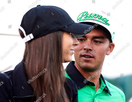 Stock Image of Rickie Fowler speaks to his friend Alexis Randock during the honorary tee off the first round of the Masters golf tournament, in Augusta, Ga