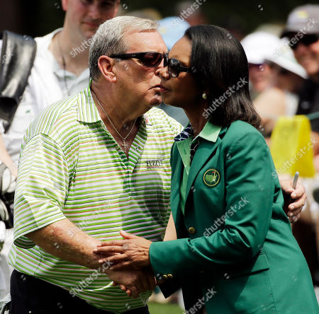 Fuzzy Zoeller kisses former Secretary of State Condoleeza Rice during the Par 3 contest at the Masters golf tournament, in Augusta, Ga