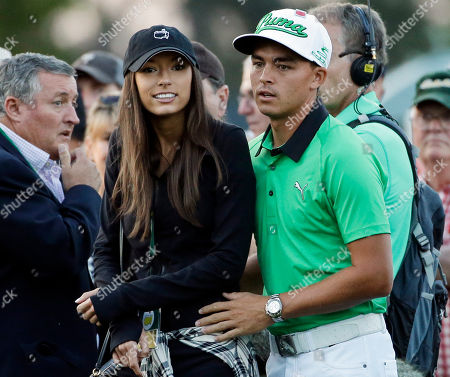Rickie Fowler stands with his friend Alexis Randock before the honorary first tee during the first round of the Masters golf tournament, in Augusta, Ga