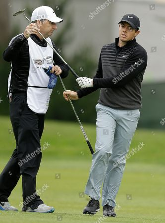 Rory McIlroy, J. P. Fitzgerald Rory McIlroy, right, of Northern Ireland, exchanges clubs with caddy J. P. Fitzgerald during round three of the Match Play Championship golf tournament at TPC Harding Park, in San Francisco