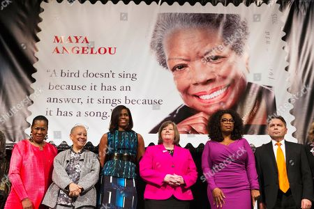 Michelle Obama, Oprah Winfrey, Megan Brennan, Eleanor Traylor, Nikki Giovanni, Ross Rossin First lady Michelle Obama participates in the unveiling of the Maya Angelou Forever Stamp, at the Warner Theater in Washington. From left are, Eleanor Traylor, English Professor at Howard University; poet Nikki Giovanni; Mrs. Obama; Postmaster General Megan Brennan; Oprah Winfrey, and artist Ross Rossin