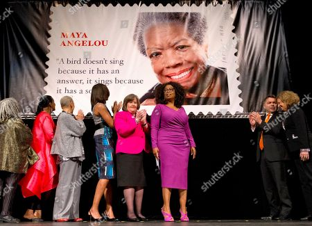 Michelle Obama, Oprah Winfrey, Megan Brennan, Sonia Sanchez, Eleanor Traylor, Nikki Giovanni, Ross Rossin, Ethel Kessler First lady Michelle Obama participates in the unveiling of the Maya Angelou Forever Stamp, at the Warner Theater in Washington. From left are, poet Sonia Sanchez; Eleanor Traylor, English Professor at Howard University; poet Nikki Giovanni; Mrs. Obama; Postmaster General Megan Brennan; Oprah Winfrey, artist Ross Rossin, and Ethel Kessler, art director for stamps with the U.S. Postal Service