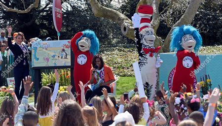 "Stock Photo of Michelle Obama, Genevieve Goings First lady Michelle Obama reads, ""Oh, The Things You Can Do That Are Good For You!,"" a Dr. Suess inspired book by Tish Rabe, during the Easter Egg Roll festivities on the South Lawn of the White House in Washington, . At left is Genevieve Goings, the star of ""Choo Choo Soul"" on Disney Junior"