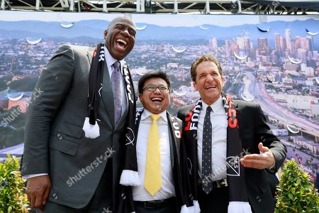 Magic Johnson, Henry Nguyen, Peter Guber Investors, Magic Johnson, left, Henry Nguyen, middle, and entertainment mogul, Peter Guber, pose for photographs after announcing the expansion of Los Angeles Football Club, LAFC, in South Los Angeles on . Major League Soccer's expansion Los Angeles Football Club is planning a $250 million stadium that would be built on the site of the Sports Arena next to Los Angeles Memorial Coliseum