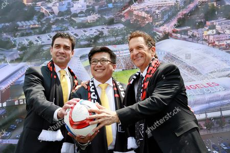 Tom Penn, Henry Nguyen, Peter Guber Los Angeles Football Club, co-owners, from left: Tom Penn, Henry Nguyen, and Peter Guber, pose for photographers, after announcing the expansion of Los Angeles Football Club, LAFC in South Los Angeles on . Major League Soccer's expansion Los Angeles Football Club is planning a $250 million stadium that would be built on the site of the Sports Arena next to Los Angeles Memorial Coliseum