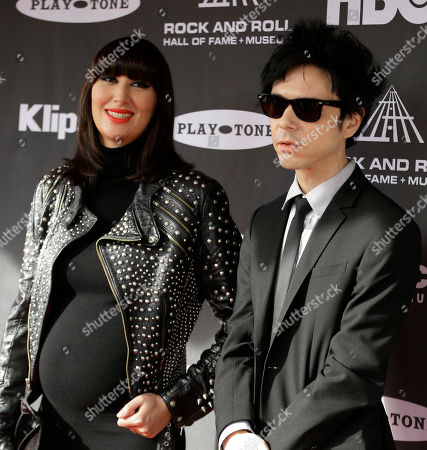 Karen O and Nick Zinner Karen O and Nick Zinner arrive at the Rock and Roll Hall of Fame Induction Ceremony, in Cleveland
