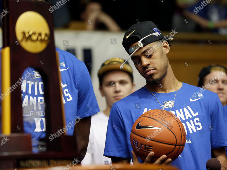 Quinn Cook Duke's Quinn Cook holds a ball as members of the Duke basketball team are welcomed during a homecoming celebration at Cameron Indoor Stadium in Durham, N.C. Duke defeated Wisconsin Monday night in the NCAA Final Four tournament championship game