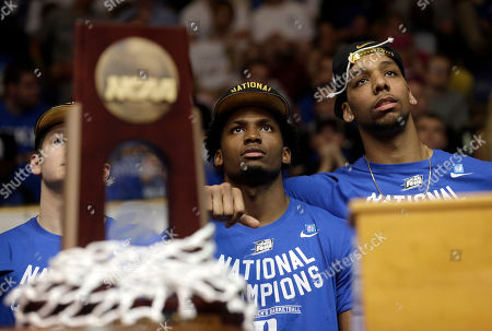 Grayson Allen, Justise Winslow, Jahlil Okafor Grayson Allen, left, Justise Winslow, center, and Jahlil Okafor watch a video during a homecoming celebration for the national championship team at Cameron Indoor Stadium in Durham, N.C. Duke defeated Wisconsin Monday night in the NCAA Final Four tournament championship game