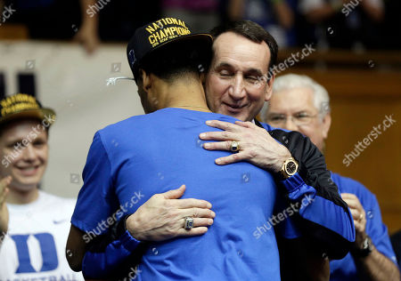 Mike Krzyzewski, Quinn Cook Duke coach Mike Krzyzewski hugs Quinn Cook as the Duke basketball team is welcomed during a homecoming celebration at Cameron Indoor Stadium in Durham, N.C. Duke defeated Wisconsin Monday night in the NCAA Final Four tournament championship game