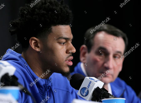 Duke head coach Mike Krzyzewski, right, watches as Quinn Cook speaks during a news conference for the NCAA Final Four college basketball tournament championship game, in Indianapolis