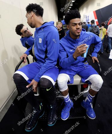 Duke's Tyus Jones, from left, Jahlil Okafor and Quinn Cook get a ride after a news conference for the NCAA Final Four college basketball tournament championship game, in Indianapolis