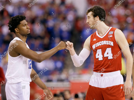 Duke's Justise Winslow, left, greets Wisconsin's Frank Kaminsky at the start of the NCAA Final Four college basketball tournament championship game, in Indianapolis