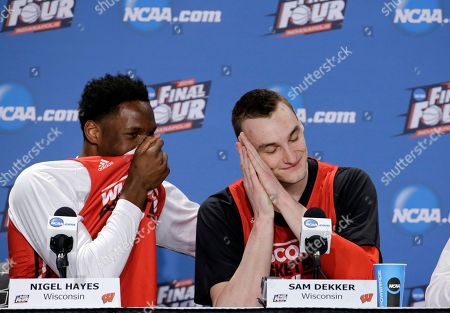 Wisconsin's Nigel Hayes and Sam Dekker have some fun during a news conference for the NCAA Final Four college basketball tournament championship game, in Indianapolis
