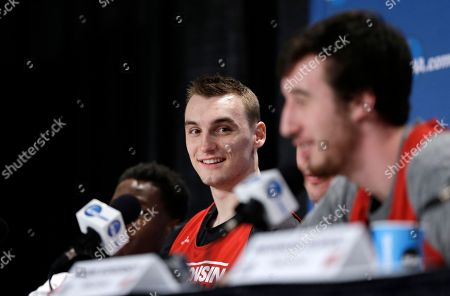 Wisconsin's Sam Dekker, left, smiles as he watches Frank Kaminsky speaking during a news conference for the NCAA Final Four college basketball tournament championship game, in Indianapolis