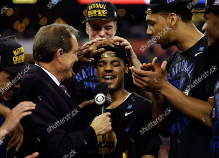 Duke's Quinn Cook celebrates after his team's 68-63 victory over Wisconsin in the NCAA Final Four college basketball tournament championship game, in Indianapolis