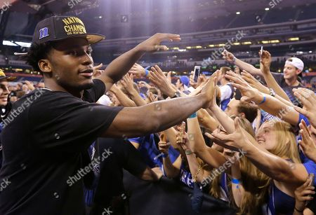 Duke's Justise Winslow celebrates with fans after his team's 68-63 victory over Wisconsin in the NCAA Final Four college basketball tournament championship game, in Indianapolis
