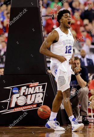 Duke's Justise Winslow reacts during the second half of the NCAA Final Four college basketball tournament championship game against Wisconsin, in Indianapolis