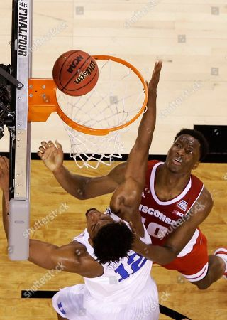 Wisconsin's Nigel Hayes, right, shoots over Duke's Justise Winslow during the first half of the NCAA Final Four college basketball tournament championship game, in Indianapolis