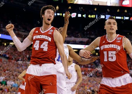 Wisconsin's Frank Kaminsky (44) and Sam Dekker (15) celebrate after a foul call during the first half of the NCAA Final Four college basketball tournament championship game, in Indianapolis