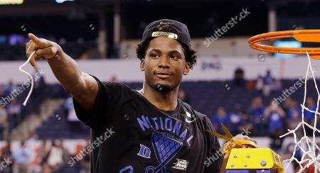 Duke's Justise Winslow cuts down the net after his team's 68-63 victory over Wisconsin in the NCAA Final Four college basketball tournament championship game, in Indianapolis