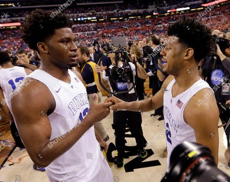 Duke's Justise Winslow, left, and Quinn Cook celebrate their 68-63 victory over Wisconsin in the NCAA Final Four college basketball tournament championship game, in Indianapolis