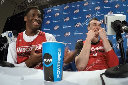 Wisconsin's Nigel Hayes and Sam Dekker have some fun during the first half of the NCAA Final Four college basketball tournament championship game, in Indianapolis
