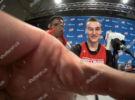 Wisconsin's Nigel Hayes and Sam Dekker adjust a camera during the first half of the NCAA Final Four college basketball tournament championship game, in Indianapolis