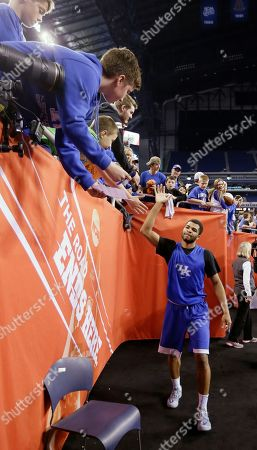 Kentucky's Andrew Harrison high fives fans after a practice session for the NCAA Final Four tournament college basketball semifinal game, in Indianapolis. Kentucky plays Wisconsin on Saturday