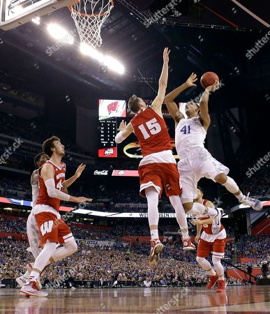 Kentucky's Trey Lyles (41) shoots over Wisconsin's Sam Dekker (15) during the first half of the NCAA Final Four tournament college basketball semifinal game, in Indianapolis