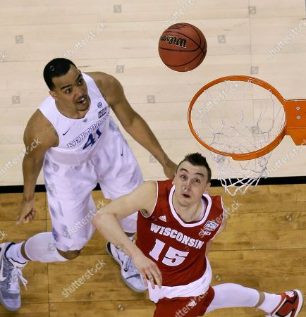 Wisconsin's Sam Dekker drives to the basket past Kentucky's Trey Lyles, left, during the first half of the NCAA Final Four tournament college basketball semifinal game, in Indianapolis