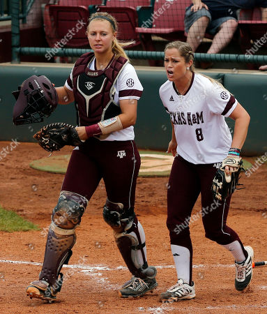 Ashley Walters, Rachel Fox Texas A&M catcher Ashley Walters, left, and pitcher Rachel Fox, right, celebrate after Walters tagged out Lehigh's Katie Schultz at the plate in the fifth inning of a Division I NCAA college softball game in Norman, Okla
