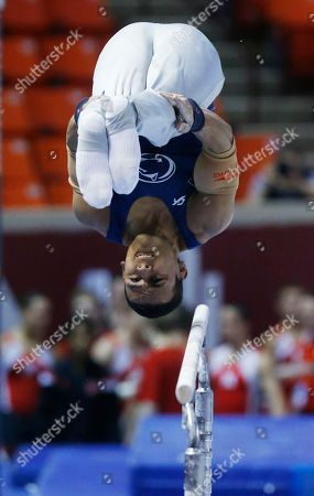 Trevor Howard Penn State's Trevor Howard competes on the parallel bars during the preliminary round of the NCAA men's gymnastics championships in Norman, Okla