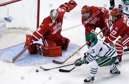 Michael Parks, Matt O'Connor North Dakota forward Michael Parks (15) has his shot stopped by Boston University goalie Matt O'Connor during the second period of a semifinal at the NCAA men's Frozen Four hockey tournament in Boston