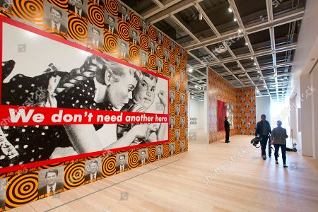 """Barbara Kruger, David Moffett Barbara Kruger's """"Untitled (We Don't Need Another Hero)"""" is displayed with David Moffett's """"He Kills Me"""" at the Whitney Museum of American Art in New York. The Whitney officially opens May 1 with an inaugural exhibition that showcases the airy, light-infused building and the breadth and depth of its permanent collection"""