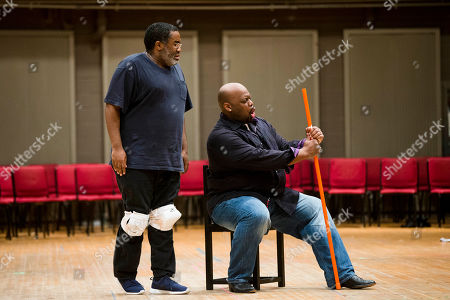 """Morris Robinson, Eric Owens Eric Owens, left, and Morris Robinson perform during a rehearsal of the opera """"Don Carlo,"""" at the Academy of Music in Philadelphia. Five performances are scheduled to be staged from April 24 to May 3"""