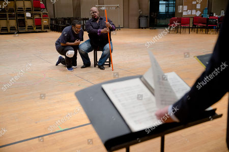 """Morris Robinson, Eric Owens Eric Owens and Morris Robinson perform during a rehearsal of the opera """"Don Carlo,"""" at the Academy of Music in Philadelphia. Five performances are scheduled to be staged from April 24 to May 3"""