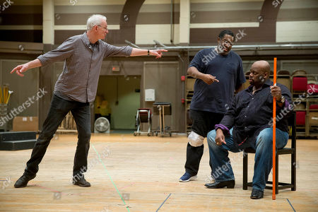 """Morris Robinson, Eric Owens, Tim Albery Morris Robinson, right, and Eric Owens, center, work with director Tim Albery during a rehearsal of the opera """"Don Carlo,"""" at the Academy of Music in Philadelphia. Five performances are scheduled to be staged from April 24 to May 3"""